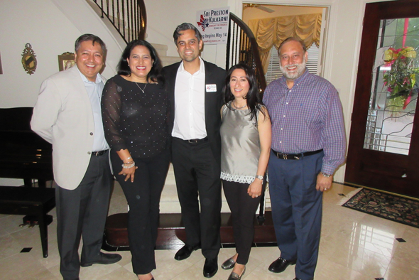 Sri Preston Kulkarni, the democratic candidate in the upcoming May 22 Democratic primary runoff for the District 22 Congressional seat, is flanked by hosts (from left) Rick and Tanya Pal and Hardeepak and Preet Munday at a fundraiser in the Munday house on May 3.