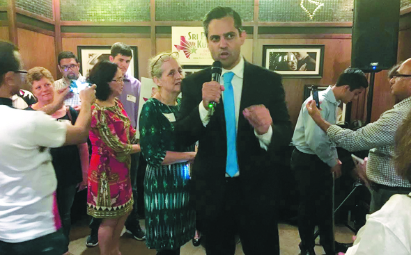 With his mother Margaret at his side, Sri Preston Kulkarni thanked his volunteers for the successful runoff campaign.