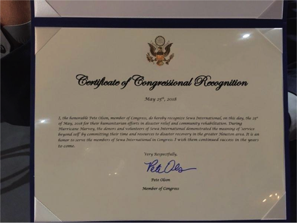 Another certificate received by Sewa International was the Certificate of Congressional Recognition signed by Pete Olson, Representing the 22nd District of Texas