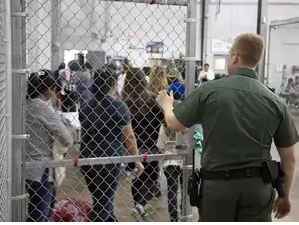 A view of inside US Customs and Border Protection (CBP) detention facility shows detainees inside fenced areas at Rio Grande Valley Centralized Processing Center in Rio Grande City, Texas, US.