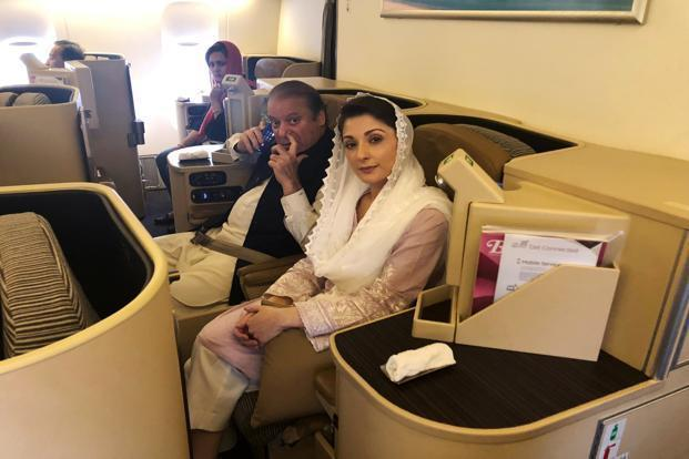 Ousted Pakistani Prime Minister Nawaz Sharif and his daughter Maryam sit on a Lahore-bound flight due for departure at Abu Dhabi International Airport UAE on 13 July 2018