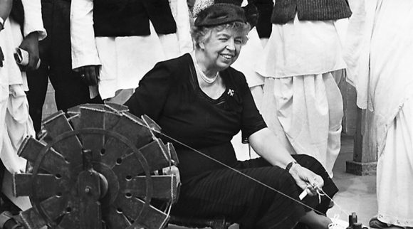 Former First Lady Eleanor Roosevelt at a spinning wheel in Delhi.