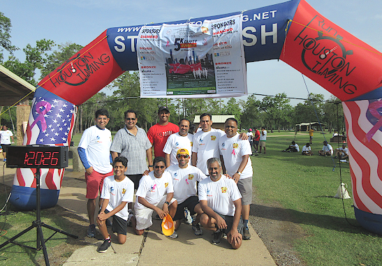 The organizers of the AKKA 5K charity run/walk for Cancer Awareness at Bear Creek Park pose under their start-stop archway last Sunday, August 12. AKKA President Shivamurthy Keelara is kneeling, second from left.