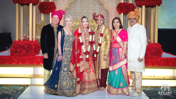 The newlyweds Hiren and Casey Joshi with their parents Richard and Merrilee Espinosa (on the left) and Rakesh and Shoba Joshi on the right.