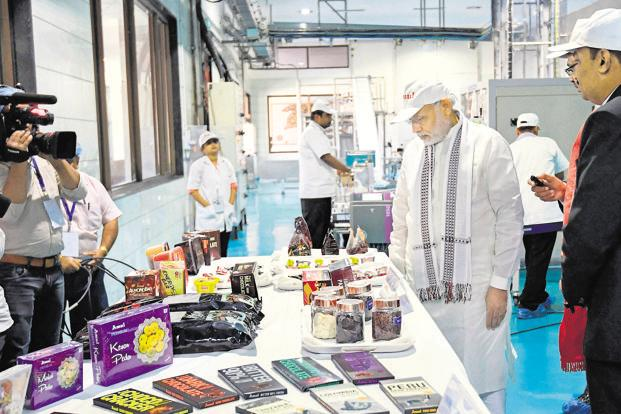 PM Modi at the Amul factory in Anand, Gujarat on Sunday. Photo: PTI