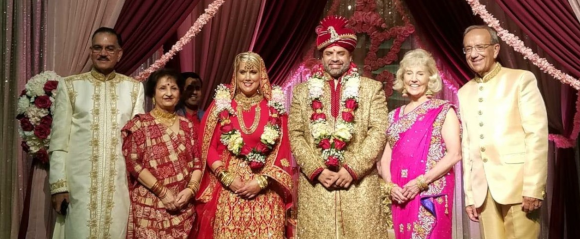 Sanjay Sharma and Maggie Budzien after their Hindu wedding on September 22, with their parents Jay and Mary Budzein on right and Sunil and Rashmi Sharma on left.