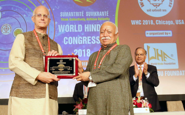 Anuttama Das of ISKCON receiving the award from Dr. Mohan Bhagwat