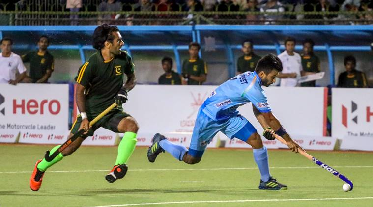 India centre-half Manpreet Singh received a pass just inside India's half, and embarked on a mazy run, with Pakistan forward Ali Shan shadowing him closely. (PTI Photo)