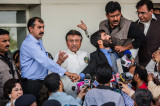 Musharraf Greeted in Pakistan by Threats and Small Crowds