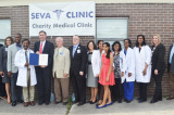 Congressman Pete Olson Presents Certificate of  Congressional Recognition to Seva Clinic