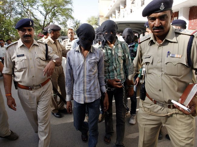 Five men in Madhya Pradesh, India, were led to court this week to face charges in the March 15 gang rape of a Swiss tourist.
