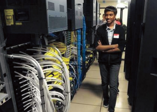 Sushain Cherivirala, 15, of Sugar Land, Texas, a student at Dulles High School and a winner of IBM's Master the Mainframe competition takes a tour at IBM's facility in the Town of Poughkeepsie. Karl Rabe/Poughkeepsie Journal