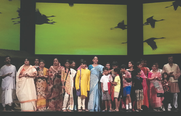 Performers on stage after the play, from the narrative drama Jagruti.