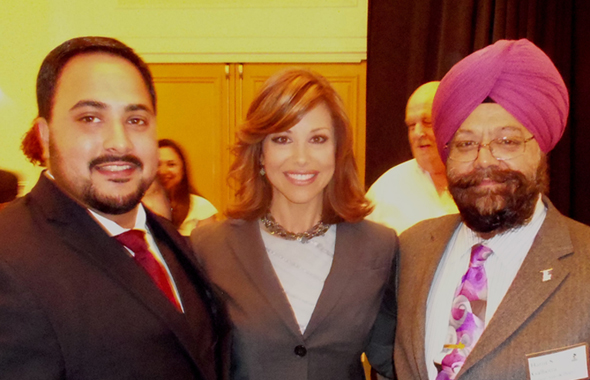 Harjit Galhotra (right) and his son Balraj Galhotra(left) with channel 2 news anchor Dominique Sesche, who was the emcee for the awards program.