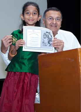 Meghna Prabhakaran receiving Gita Chanting certificate from Acarya Gaurang Nanavaty.