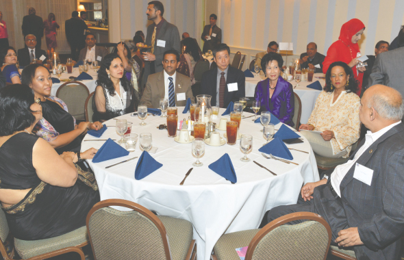 IDA Houston President Dr. Kulvinder S. Bajwa networking at the event.