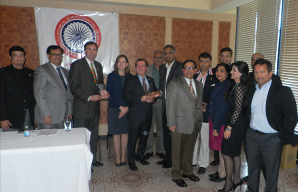 California Congressman Ed Royce and his wife Marie received a plaque from IAPAC President Sujeeth Draksharam at Mayuri restaurant during a brief stopover in Houston this past Saturday, May 11 as members of the IAPAC Board and Texas Congressman Pete Olson look  on.            Photo: Jawahar Malhotra
