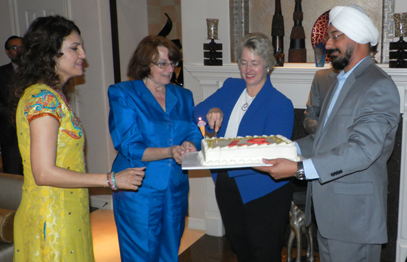 Mayor Parker cuts her birthday cake as (from left) Jasmeeta Singh, Kathy Hubbard, and Harry Singh look on.        Photos: Jawahar Malhotra