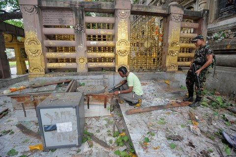 Krishna Murari Kishan/ReutersSecurity personnel inspect the site of an explosion inside the Mahabodhi temple complex at Bodh Gaya, Bihar on July 7.