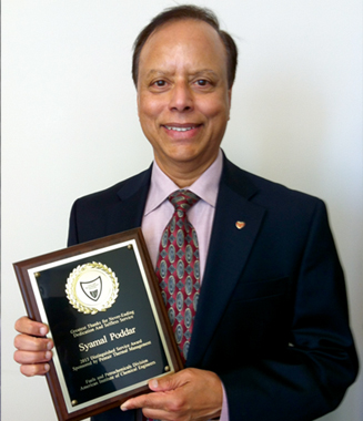 Dr. Syamal Poddar with the AIChE Distinguished Services award plaque.