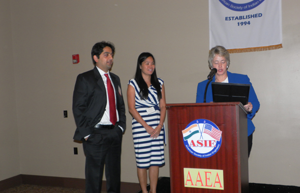 """Mayor Parker reads a proclamation of making August 15, 2013 """"ASIE & AAEA Day"""" as the organizations' Presidents Vishal merchant and Andrea Ranft look on."""