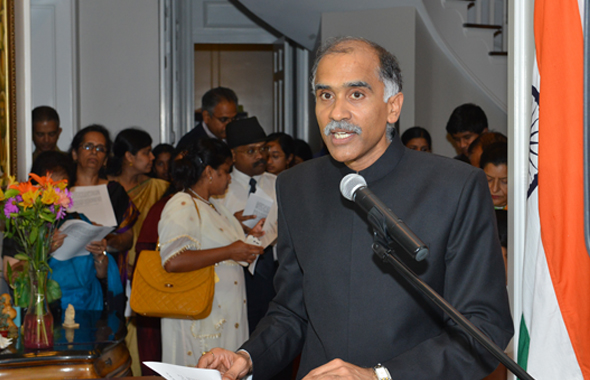 The Indian Consul General Parvathaneni Harish read from the Indian President's speech inside the living room as the rainy weather pushed everyone indoors.