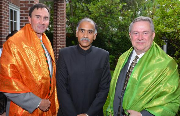 Congressmen Pete Olson (left) and Steve Stockman flank Consul General Harish.       Photos: Bijay Dixit