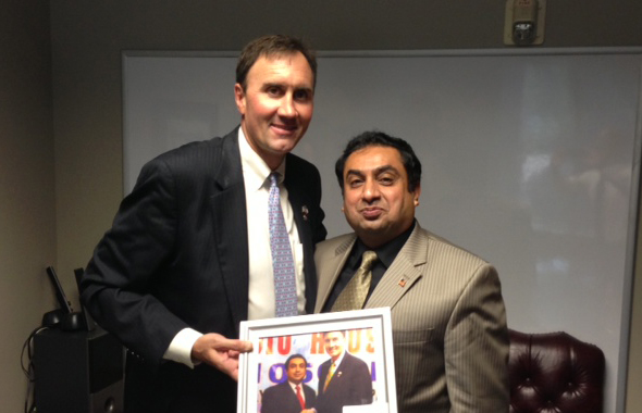 Congress Member Pete Olson (left) with  Rahman Moton, President Myanmar American Chamber of Commerce and CEO Radio Houston.