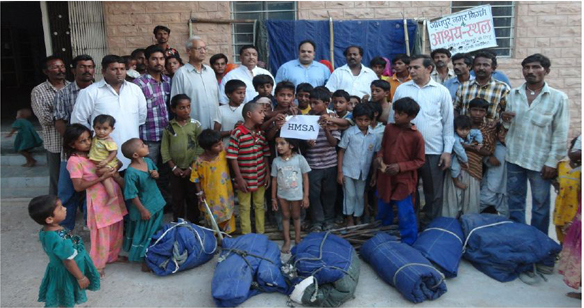 From left: Dhananjay & Vikram Parihar (Bajrang Dal), Prof. B.L.Mathur, Prahalad Goel (VHP), Rahul Chandra (HMSA), Chetan Ram (Refugee Grp Leader), Om Prakash Boob (Sr. Advocate) at Jodhpur Municipal Shelter home based tent donation event.