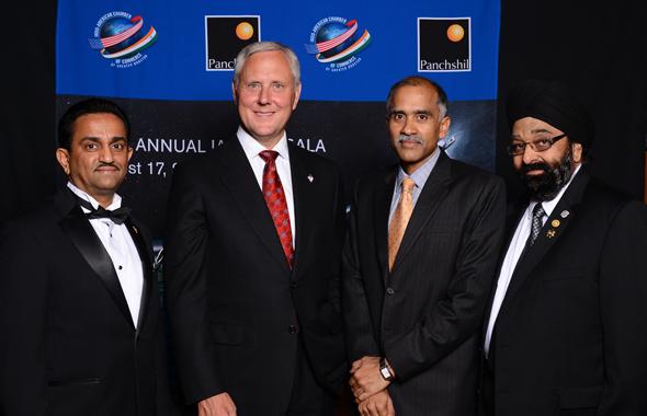 IACCGH President Pankaj Dhume, Consul General Harish, BMC Software President Bob Beauchamp and Chamber Executive Director Jagdip Ahluwalia at the Chamber Gala.