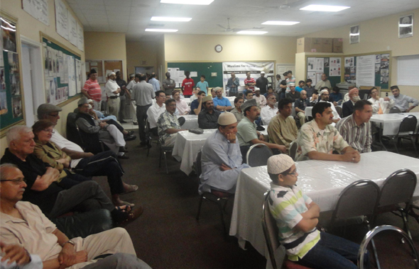 Guests from other faiths and Members of Ahmadiyya Muslim Community, Houston are listening to the presentation on Ramadan.