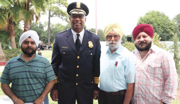 From left: Gurmeet Singh Kindra, Police Chief McClleland, Kanwaljeet Singh, President of Sikh Center, Raju Ahuja.