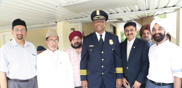 Houston Police Chief Charles McClelland Jr. (in uniform) attended a Rememberance Service on the first anniversary of the Oak Creek massacre last Sunday, August 11. With him, from the right are Bobby Singh and HPD Office Muzzafar Siddiqui,  Raju Ahuja and other guests.        Photos: Jaswant Singh