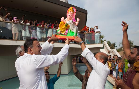 "Amid loud chants of ""Ganapati Bapa Morya, Puduchya Varshi lavkarya,"" parents and children watched the beautiful big Ganesha idol submerge in the pool below the Sivalaya.Photo: Jayesh Mistry"