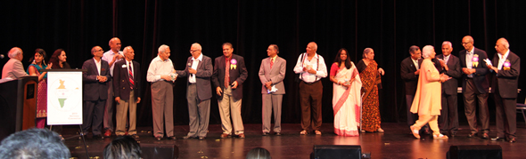 ISCA Houston Committee Members and other dignitaries on stage.