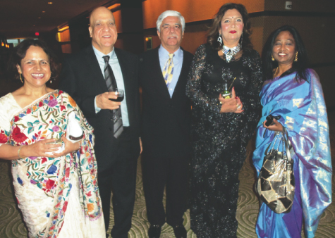 IACF Founder Vinod Bhuchar (center) who spoke about how he had the idea to start the group, poses with guests (from left) Usha and Tej Ganju, Chandrika Sharma and Shobana Muratee (right).