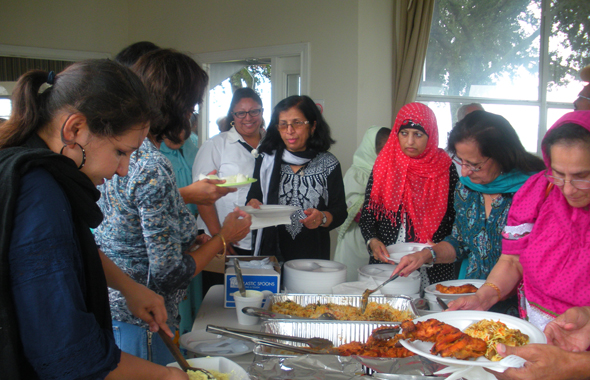 At lunch, Parvin Shaikh and Paru McGuire helping Members FouziaRawat, Rabea Effendi, Noor Pasha.