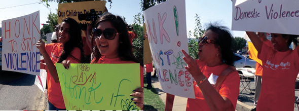 Teenagers and adult volunteers joined in displaying handmade posters urging passing motorists to honk in support of ending domestic violence.