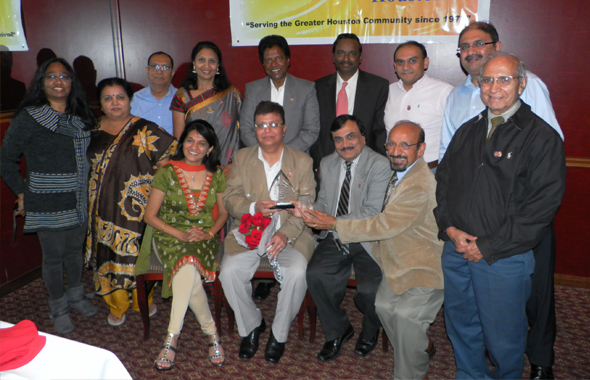 A few of the Trustees and the current Board members of the India Culture Center presented Anil Matta with a bouquet, plaque and a glass encased white statue of Ganesh. Photos: Jawahar Malhotra