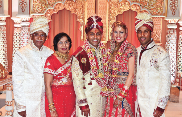 The newlyweds with Ajay's family, from left, dad Swatantra, mom Bimla and brother Manish after the wedding.
