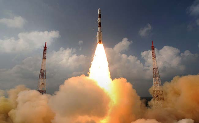 PSLV-C25 launch vehicle carrying the Mars Orbiter probe as its payload lifting off from the launch pad in Sriharikota