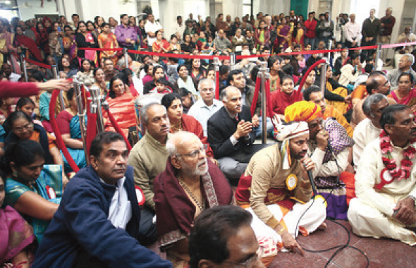 Consul General of India, P. Harish and MTS devotees having the first glimpse of Prasanna Ganapathy inHis new Sanctumin the Garnaite Garbagriha.