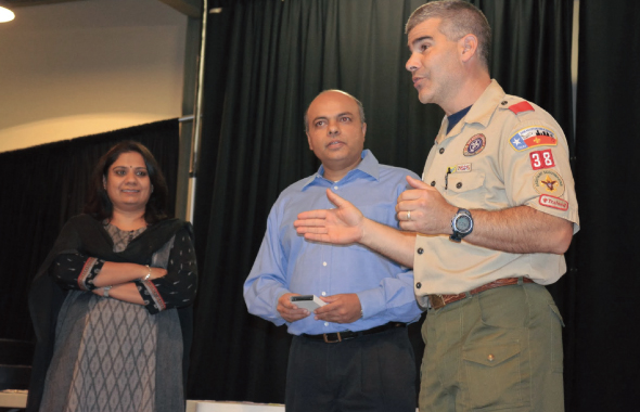 Carl Sedita, ASM Troop 38, introduces Bimal Radia and Priti Parikh for Dharma Award distribution to the Boy Scouts of Troop 38.  From left: Priti Parikh, Bimal Radia, and Carl Sedita.