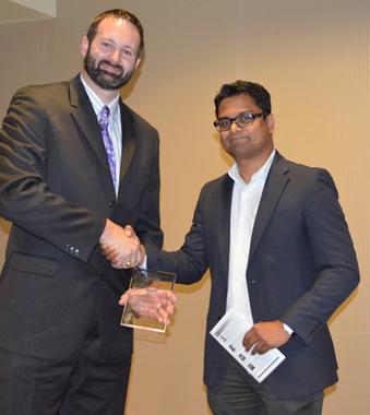 Karthik Balasubramanian receiving a Young Engineer of Year 2014 Award from Brent Baldwin, Houston Engineers Week Committee Member.