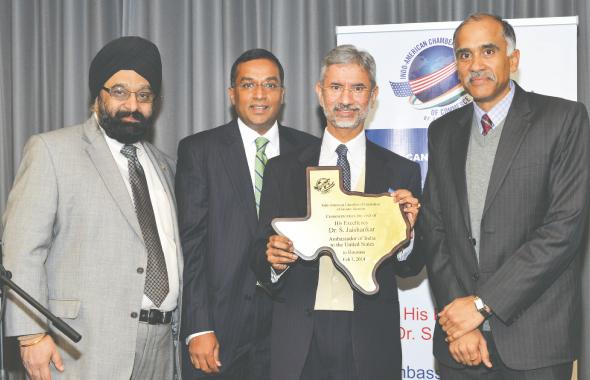 IACCGH Executive Director Jagdip Ahluwalia and President Sanjay Ramabhadran present a Texas shaped plaque to Indian Ambassador Jaishankar as Consul General P. Harish looks on.          Photos: Bijay Dixit