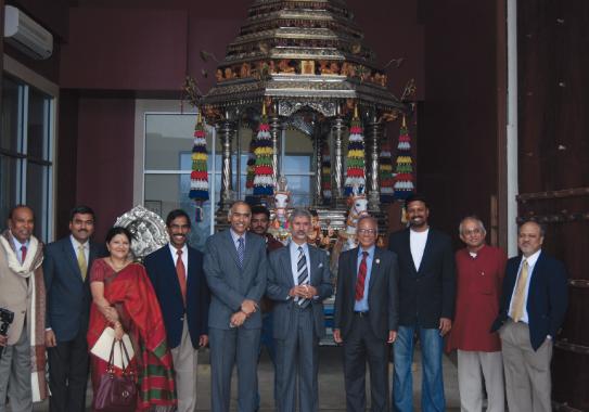 In front of the majestic Ratham, Indian Ambassador Dr. Subrahmanyam Jaishankar, and Consul General Parvathaneni Harish, and visitors with MTS executive board and Sam Kannappan.