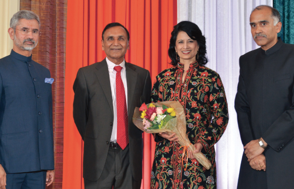 From left: Ambassador Jaishankar felicitating Pravasi Bharatiya Samman Awardee Dr. Renu Khator,  Suresh Khator, and Consul General P. Harish.