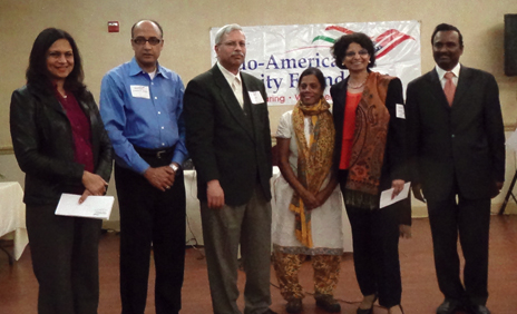 IACF Treasurer Neeta Balsaver (left), IACF Board Member Nanda Vura, IACAN Treasurer V. K. Dorai, IACAN Board Member Indu Gosar, IACAN President Kanchan Kabad and IACF President Ramesh Cherivirala.
