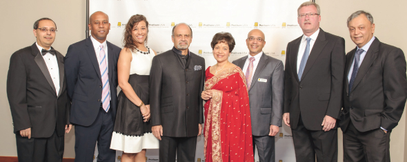 From left: Dr.Atul Varadhachary, Outgoing President, Pratham USA, Julius and Michelle Young, Wells Fargo, Dinny Devitre, Chairman Pratham USA, Dr. Marie Goradia, President, Pratham Houston, Vijay Goradia, Founder Pratham USA, Mike Schmittlein, Wells Fargo, Dr. Madhav Chavan, Founder, Pratham India.