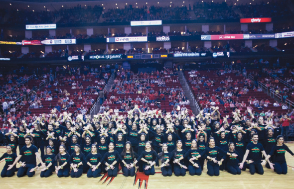 Rhythm India's 95 performers, during the Rockets vs. Clippers, half time show at the the Toyota Center last Saturday, March 29.Below: Arzan Gonda (front) with a group of participants before their performance.             Photos: Navin Mediwala